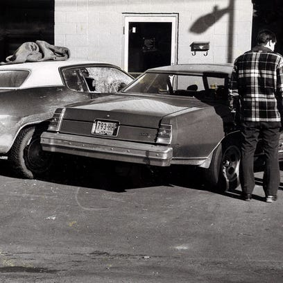New York State Police investigators check the crime scene at a Corning car wash in 1980 where investigator Robert Van Hall and investigator William Gorenflo were ambushed while inside the vehicle on the left. Van Hall died, and Gorenflo was severely injured. Joseph Comfort, who was convicted of murder, was recently denied parole.