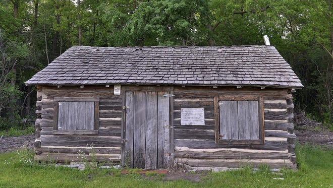 The Pioneer's Cabin at the Stearns History Museum was built about 1855 by Balthasar Rosenberger on Sixth Avenue South. Now the oldest house standing in St. Cloud, it has been used as a home, hotel, fort, jail, court house and claim office. It was photographed Monday.