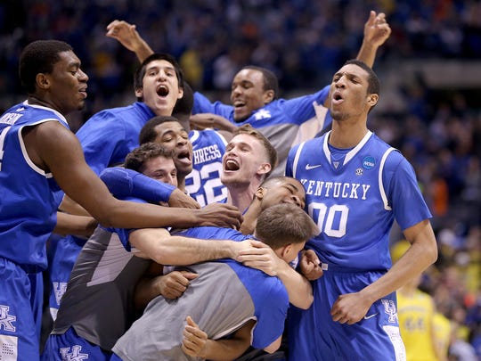 The Kentucky Wildcats celebrate their win over Michigan. Kentucky defeated Michigan 75-72 in the NCAA Division1 Men's Basketball Championship Midwest Regional championship game Sunday, March 28, 2014, at Lucas Oil Stadium.