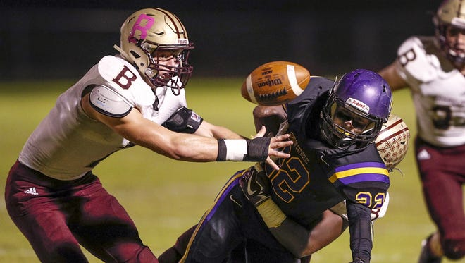 Brebeuf Jesuit Braves Clay Mayer (7) reaches for the fumbles ball ny Guerin Catholic Golden Eagles Thomas Kaser (22) in the first half of their game at Guerin Catholic High School in Nobelsville, Friday, Oct 20, 2017.