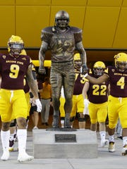 Arizona State's Demario Richard grabs the hand on the