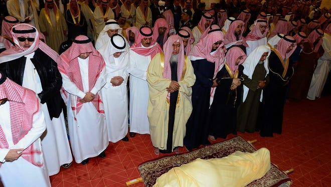 In this photo provided by the Saudi Press Agency, mourners pray standing by the body of King Abdullah during his funeral at the Imam Turki bin Abdullah mosque in Riyadh, Saudi Arabia, Friday, Jan. 23, 2015. On early Friday, Jan. 23, 2015, Saudi state TV reported King Abdullah died at the age of 90. (AP Photo/SPA)