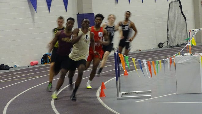 Licking Heights junior Nathaniel Amoah, front, and senior Omar Jalloh lead their heat of the 400 on Sunday during the Division I Central District Indoor meet at Capital University.
