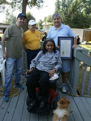 Club President Rusty Branch, Fred Knodel, Commissioner Grover Robinson, and ramp recipient Lana Campbell.