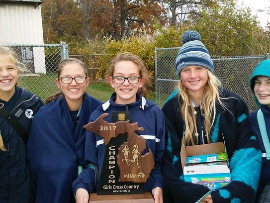 Members of the Marysville Vikings girls cross country