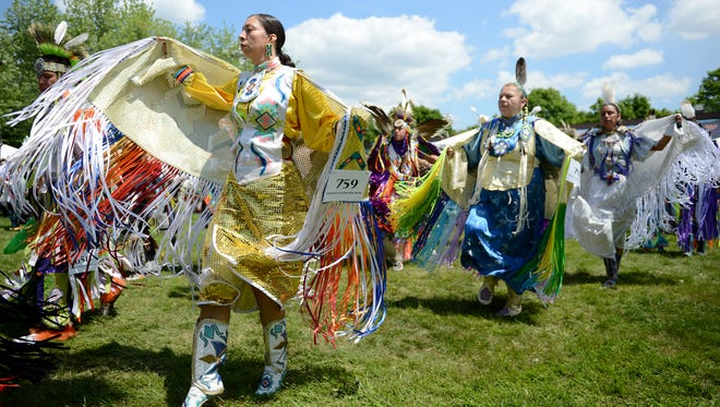 Dancers participate in the grand entry during the 42nd annual Oneida Pow Wow at Norbert Hill Center in Hobart in July 2014.