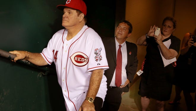 Pete Rose waits in the dugout tunnel for his introduction as the Great Eight was honored in September of 2013.
