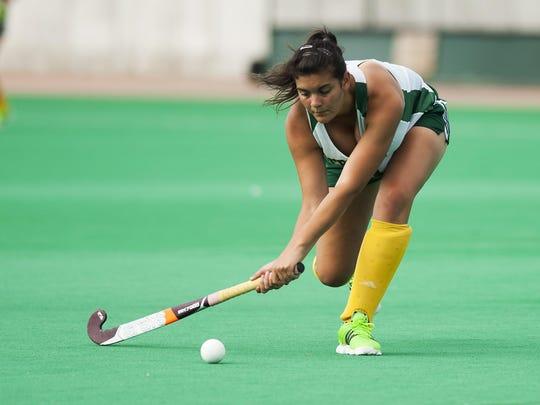 Carla Godsman, from Glasgow, Scotland, hits the ball