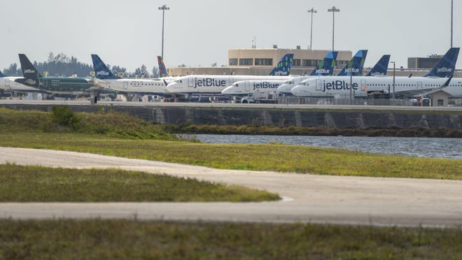 JetBlue aircraft is parked at Palm Beach International Airport in West Palm Beach on April 9 as few flights were taking off since the outbreak of the coronavirus pandemic.