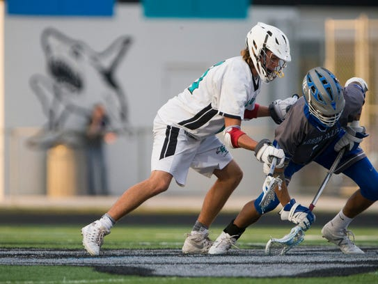 Gulf Coast and Barron Collier face off for possession