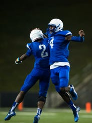 Lanier's (4) and (2) celebrate after a Lanier touchdown