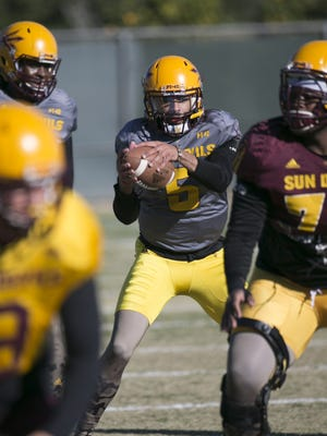 ASU quarterback Manny Wilkins takes a snap during an ASU football practice at the ASU  Kajikawa Practice Facility in Tempe on Friday, December 18, 2015.