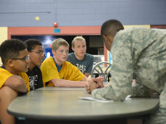 Holloman Middle School students and a volunteer from the 49th Staff Judge Advocate office discuss why they chose one of two possible bills to sign during a Constitution Day assembly hosted by 49th WG JA at Holloman Air Force Base, N.M. on Sept. 21, 2017. The students would later debate between the two bills before having one signed by the class president.