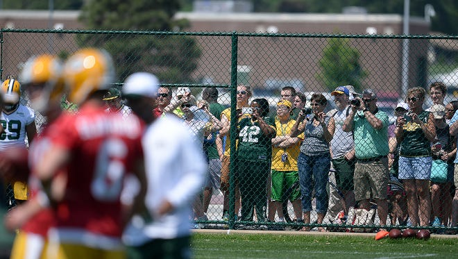 Green Bay Packers fans lined the fences to check out the team during Organized Team Activities at Clarke Hinkle Field May 28, 2015.