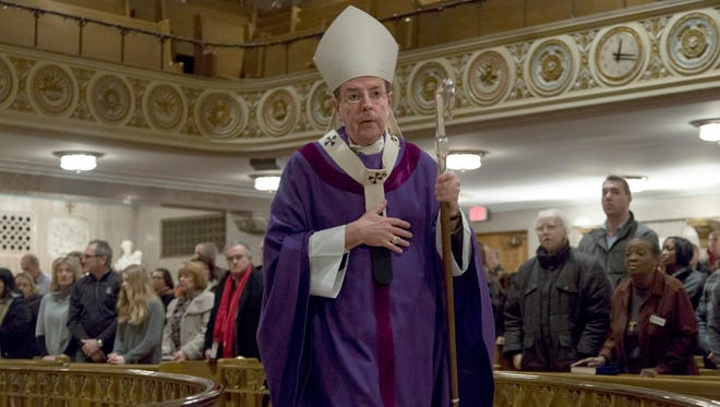 Archbishop of Detroit Allen Vigneron is pictured during Ash Wednesday services at St. Aloysius Church in Detroit. Last year, Vigneron urged Catholics who support same-sex marriage to refrain from receiving communion.