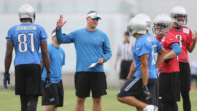 The Detroit Lions offensive coordinator Joe Lombardi  works with players during practice on Thursday, June 18, 2015 at the Lions Allen Park practice facility.