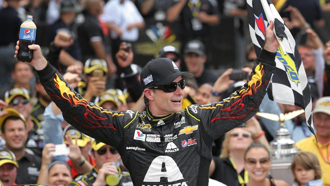 Jeff Gordon celebrates his fifth Brickyard 400 win with a Pepsi in hand, July 27, 2014 at Indianapolis Motor Speedway.