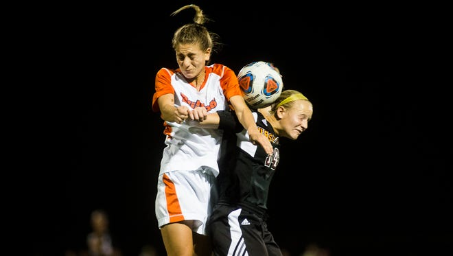 Gettysburg College's Julia Ramsey battles for the ball with Ursinus College's Jeannie Jasinski during the first round of the Centennial Conference women's soccer playoffs Wednesday at Gettysburg College. The Bears ended the Bullets season with a 3-1 victory in penalty kicks.
