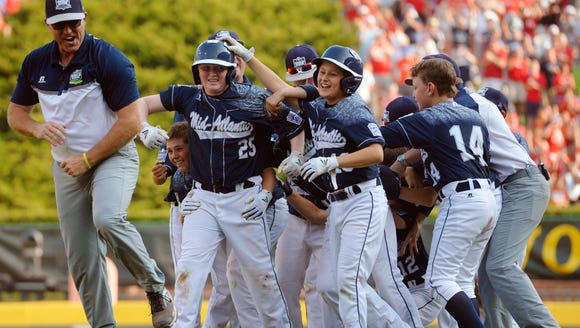 The Red Land Little League team celebrates the walk-off
