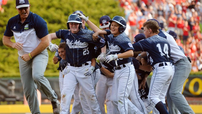 The Red Land Little League team celebrates the walk-off run that sent them to the world championship game against Japan in 2015. The players are now in high school.