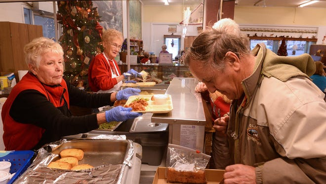 Myrna Blatter, a volunteer with Cascade County Senior Nutrition, serves lunch to Leroy Spiller on Thursday at the Great Falls Senior Center. Last year, the Senior Center served about 4,500 people as its need has tripled in the last four years.