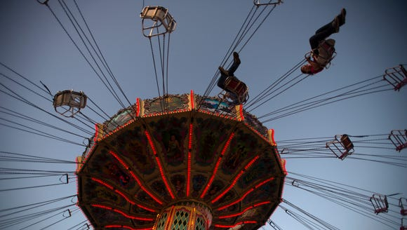 People take a ride at the Alabama National Fair on