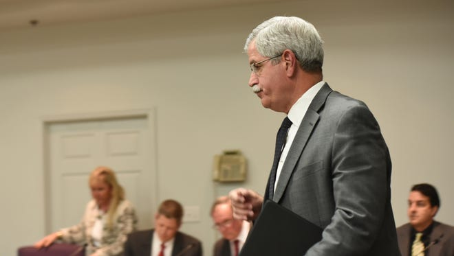 "Hamilton County Schools Superintendent Rick Smith enters a school board meeting room before a short public meeting in Chattanooga, Tenn., Wednesday, Jan. 6, 2016. Tennessee's Ooltewah High School has called off the rest of its basketball season after three of its players were arrested on charges of raping a teammate in an apparent hazing incident. Smith said he was taking this ""very unusual step"" with the high school ""so that the criminal justice system can work the way we expect."""