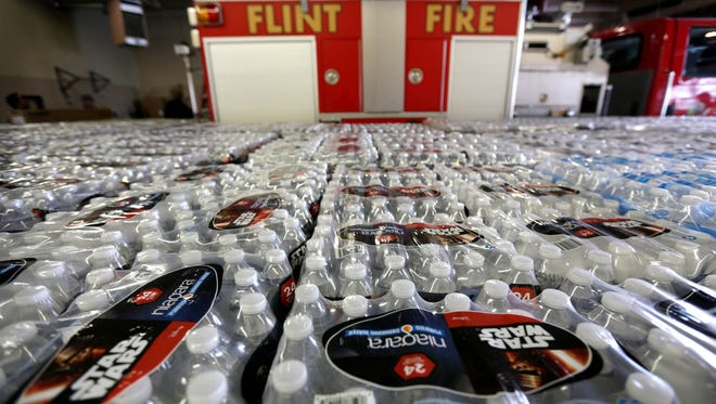 Thousands of water bottles are being handed out of the Flint Fire Station 3 in Flint on Thursday, Jan. 21, 2016.
