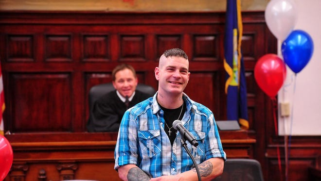 Josh Elder smiles as he delivers a speech thanking his supporters during the Veterans Court graduation ceremony Tuesday in Judge Greg Pinski's courtroom.