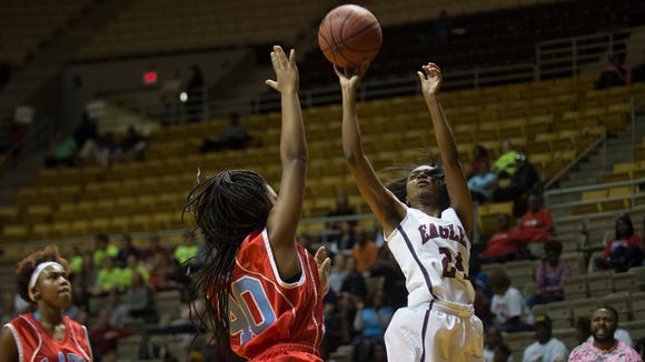 Montgomery Academy's Jade Brooks (24)  shoots over