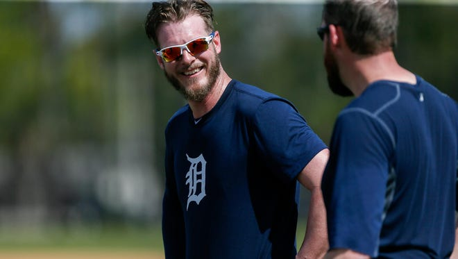 Relief pitcher Mark Lowe, left, shares a laugh with fellow pitcher Bobby Parnell on Monday at the Tigers' spring training camp.