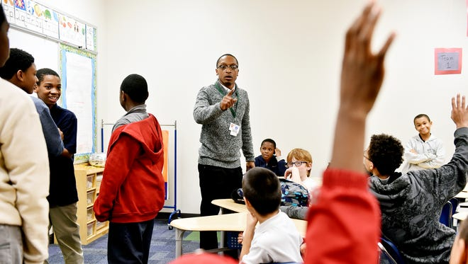 """Martin Library site coordinator Diaz Woodard, center, calls on boys to identify an appropriate response to a show of disrespect in a role-play skit during an after-school """"Boys 2 Men"""" program at Davis K-8 School.  The program, held every other Wednesday and attended by boys from third to eighth grades, is the brainchild of Woodard, who is site coordinator for the after-school program in York City schools."""