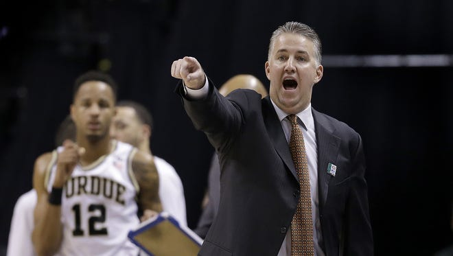 Purdue Boilermakers head coach Matt Painter in the first half of their Big Ten Men's Basketball Tournament semifinal game Saturday, Mar 12, 2016, afternoon at Bankers Life Fieldhouse. The Purdue Boilermakers defeated the Michigan Wolverines 76-59.