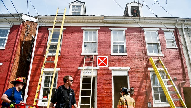 "An X sign designates a building is unsafe for firefighters to enter, as emergency officials work the scene of a fire that began in the neighboring unit Thursday, March 24, 2016, in York. The fire started in the second floor of 741 South Court Avenue, which York City Fire Chief David Michaels said appeared to be vacant but ""in some state of repair."""