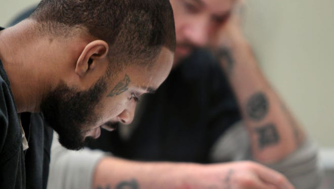 Kenton County Detention Center inmate Thomas Blackman reads from a handout in an anger management class in the jail's substance abuse program.