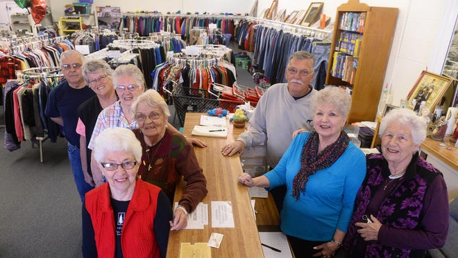 Volunteers for the St. Martin de Porres Mission include (from back to front on left) Mike Garrity, JoAnn Roach, Francis Theony, Lorraine Jenkins and Edna Kopp, and (from back to front on right) George Hilpert, Donna Delaney and Marie Stimac.