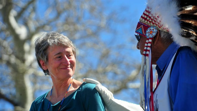 "Chief Earl Old Person honors Interior Secretary Sally Jewell with a Blackfeet name, ""Far Away Woman,"" during the land buy-back ceremony Tuesday afternoon in Browning."