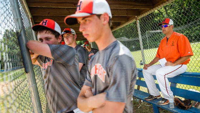 Robert Rohrbaugh, coach of High Heat Travel Baseball, at right, watches a play from the dugout with his team Saturday June 11, 2016 during a game in Chambersburg. Rohrbaugh, a native of Littlestown, was a Seattle Mariners prospect.