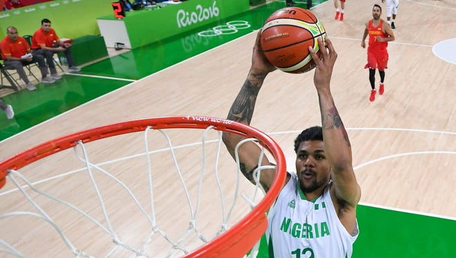 Aug 11, 2016; Rio de Janeiro, Brazil; Nigeria guard Michael Gbinije (12) goes up for a shot during the men's preliminary round against Spain in the Rio 2016 Summer Olympic Games at Carioca Arena 1.