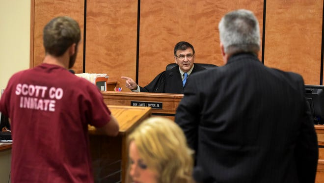Scott County General Sessions Judge James Cotton Jr. instructs Public Defender Mark Strange, right, to check with Howard Barnett about an ankle bracelet for his client, at the podium, Wednesday, Sept. 14, 2016.