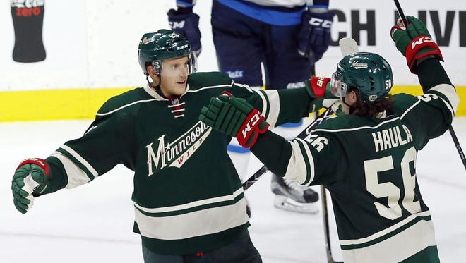 The Minnesota Wild's Erik Haula congratulates Jonas Brodin after he scored off Winnipeg Jets goalie Michael Hutchinson in the third period Saturday in St. Paul. The Wild won 4-3.
