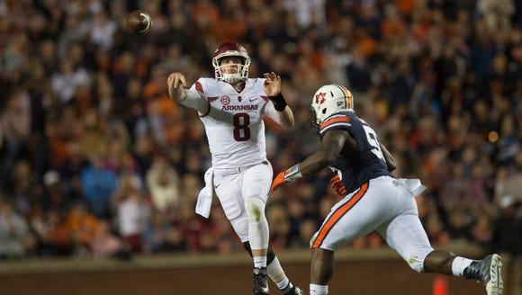 Arkansas quarterback Austin Allen (8) throw a pass