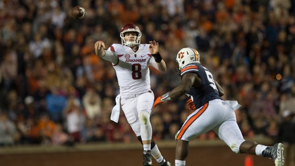 Arkansas quarterback Austin Allen (8) throw a pass as Auburn defensive lineman Carl Lawson (55) pressures him during the NCAA football game between Auburn and Arkansas Saturday, Oct. 22, 2016, in Auburn, Ala. Auburn defeated Arkansas 56-3.