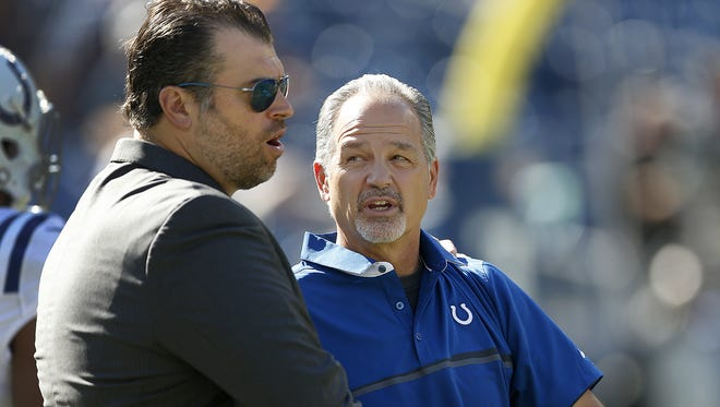 Indianapolis Colts   coach Chuck Pagano (right) and Colts General Manager Ryan Grigson talk before facing the Tennessee Titans at Nissan Stadium in Nashville on Oct. 23, 2016.