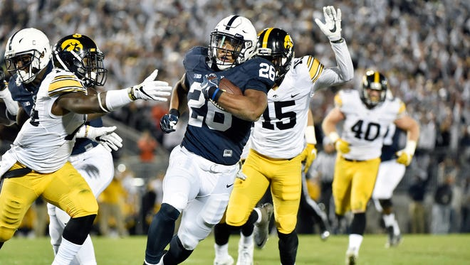 Penn State's Saquon Barkley carries the ball for a touchdown against Iowa in the first half of an NCAA Division I college football game Saturday, Nov. 5, 2016, at Beaver Stadium. Penn State hosts Iowa.