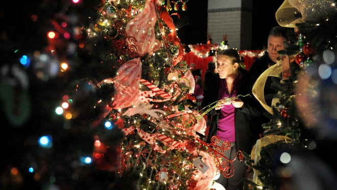 Shelby Swanson and David Swanson of Maryville check out all of the trees on display during the Fantasy of Trees at the Knoxville Convention Center Wednesday, Nov. 25, 2015.