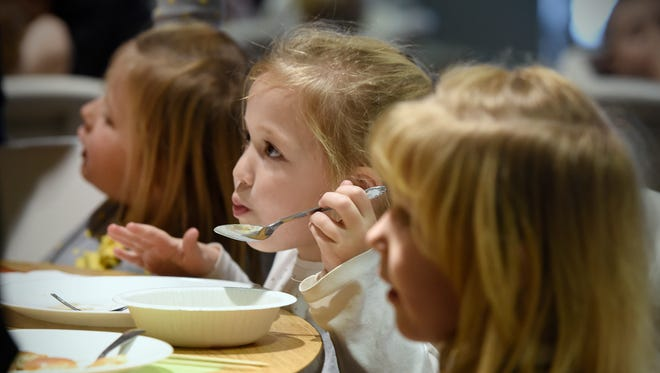 Preschool students enjoy a special Thanksgiving lunch served by volunteer parents Tuesday, Nov. 22, at the Bethlehem Lutheran Early Childhood Center in St. Cloud. The children invited church staff and members of the quilting group to eat with them.