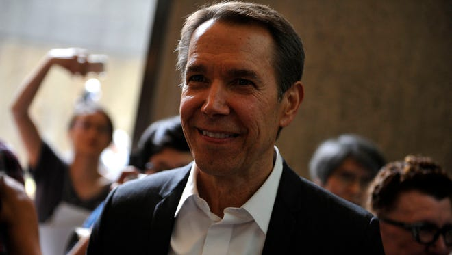 """Jeff Koons, a York County native, is surrounded by media after speaking during the media preview of """"Jeff Koons: A Retrospective"""" at the Whitney Museum of American Art in New York City in 2014."""