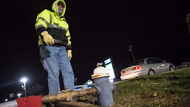 Daryl Meyers gets ready to open a water hydrant to fill up seven tankers on Friday, Dec. 2, 2016, to assist with Carlisle's water shortage.