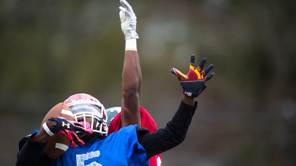 Lee's Henry Ruggs III catches a pass as Tanner's Chadarius Townsend defends during practice on Tuesday, Dec. 6, 2016, at Huntingdon College in Montgomery, Ala., for the Alabama vs. Mississippi All Star Game.